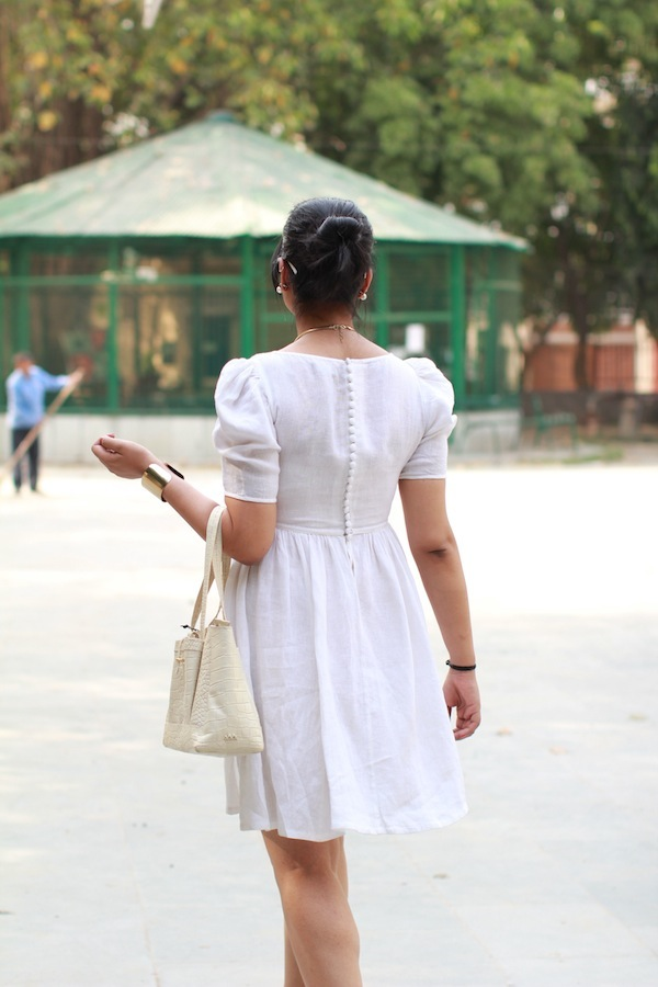 back buttons white dress