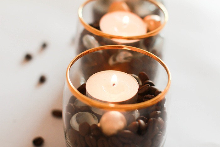 Once your candle is the right size, put candle in the middle of your mold. Place coffee beans all around the outer part of the candle. Get them as evenly distributed as possible. Stop beans about 1/4 an inch from the top of your core candle. Melt your other candle.