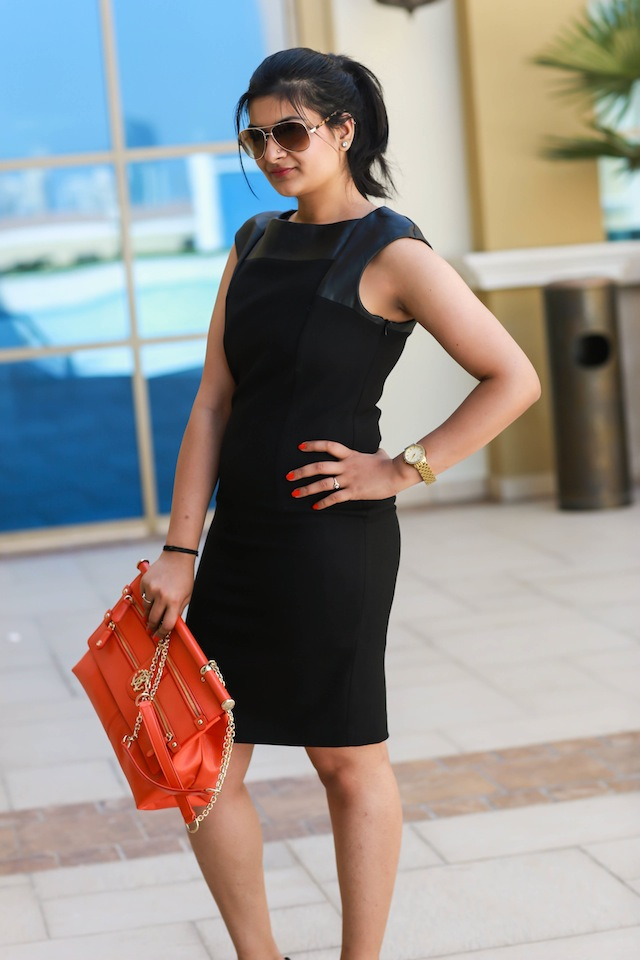 black leather dress orange bag
