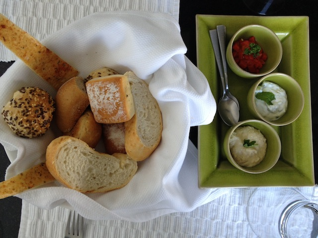 A warm bread basket with yummy dips