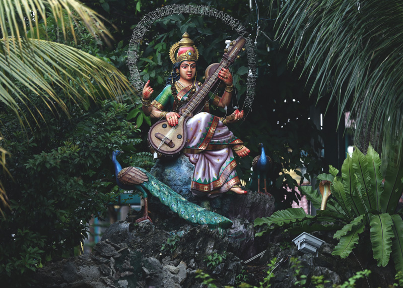 A beautiful saraswati statue before entering the cave villas