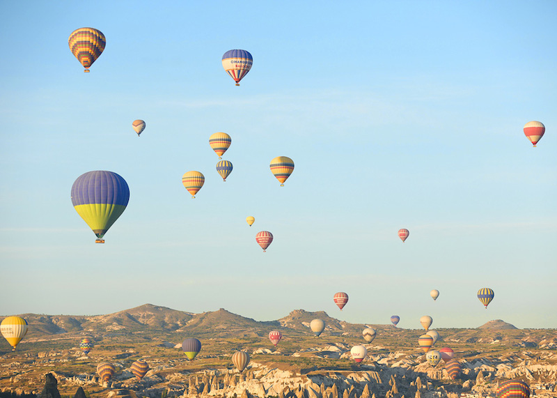 Hot air balloons dotting the sky
