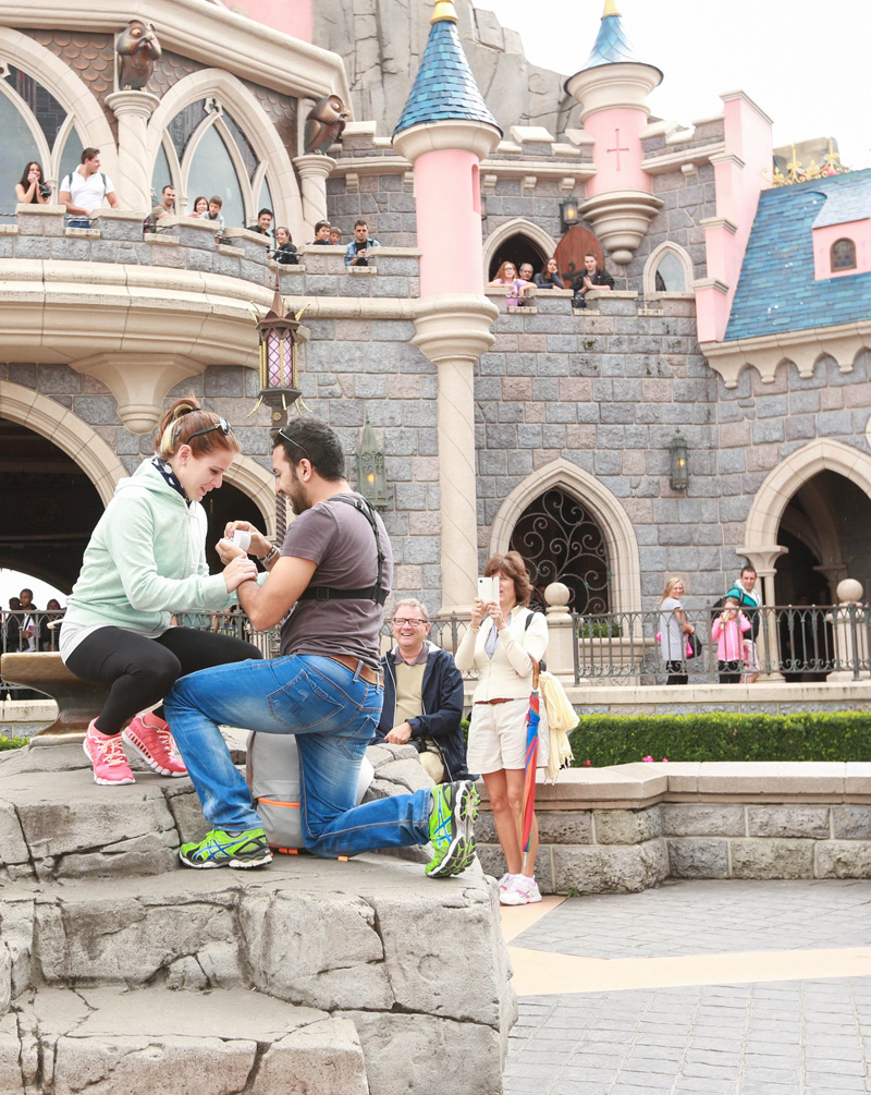 He proposed, she cried and everyone clapped!! All in Disneyland! : )