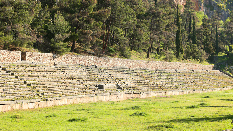 View of the mountain-top stadium of the Delphi sanctuary, used for the Pythian Games. The stone steps/seats at right were added under the Romans.