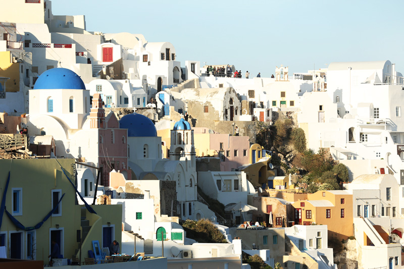 the colorful pastel shades of Santorini