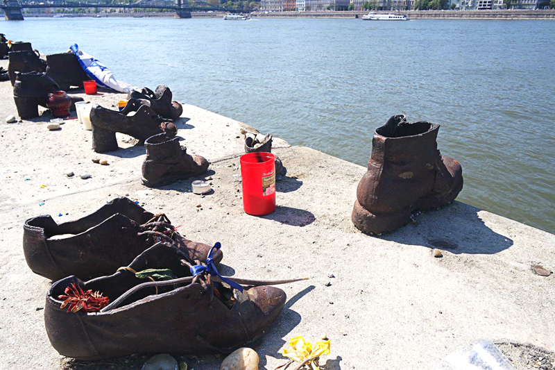 shoes by danube river. The shoes on the Danube Bank. It is a memorial created in honour of Jews who were killed during world war II . They were ordered to take off their shoes and were shot at the edge of the river so that their bodies fell into the river and were carried away. :((