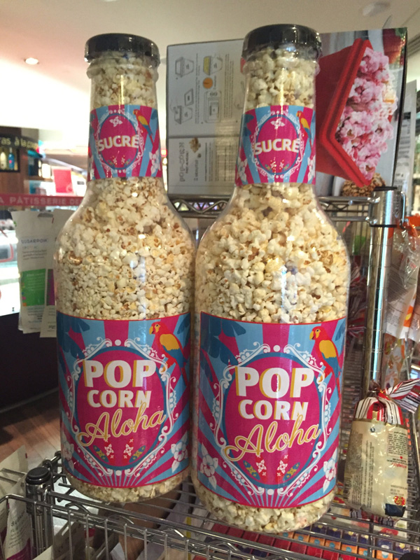 huge pop corn bottles at a grocery tore