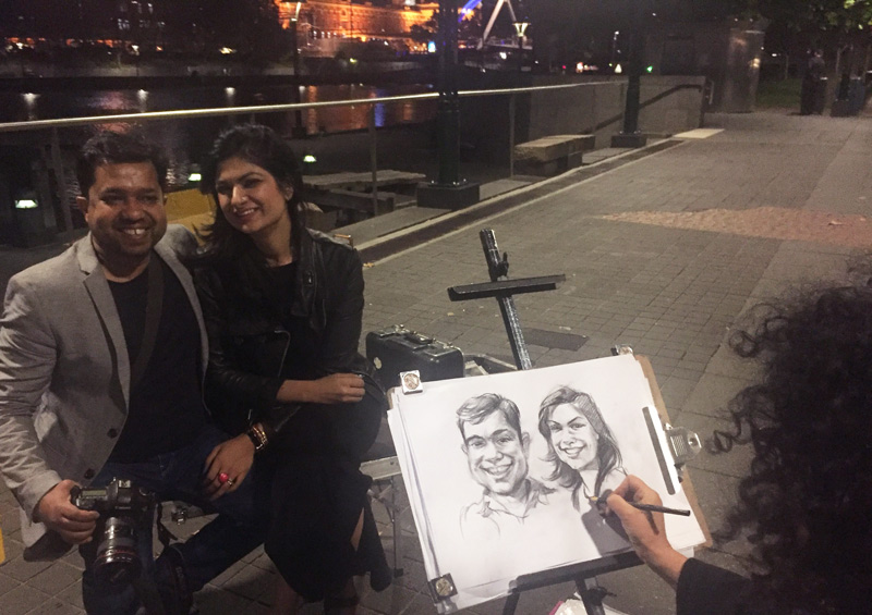 getting our caricatures done!