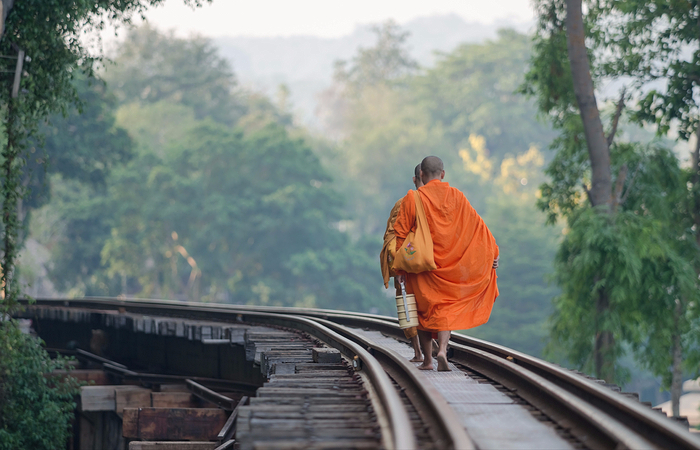 The monks walking on the Death Railway Kanchanaburi Thailand